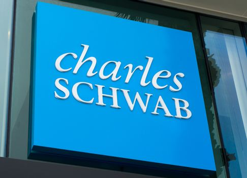 SANTA MONICA, CA/USA - MAY 12, 2016: Charles Schwab exterior sign and logo. The Charles Schwab Corporation is an American brokerage and banking company.