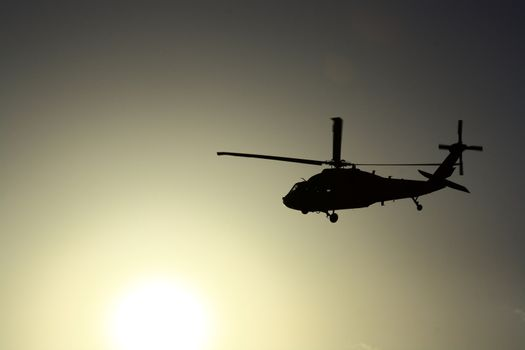 Helicopter at sunset with sun view