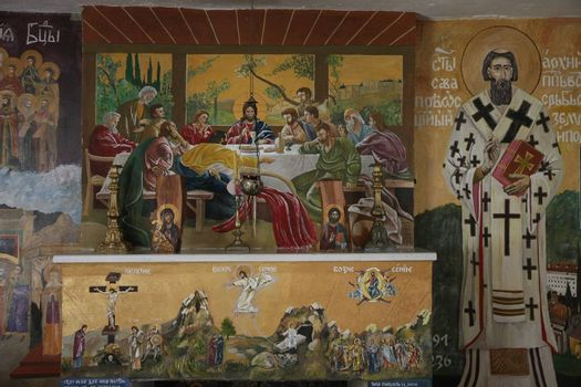 Icons on the wall in the Fan of Holy Mother of God's shroud in village Belanovica in Serbia