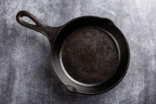 cast iron pan on dark background