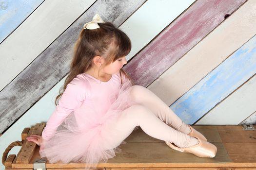 Little girl dreaming of being a ballerina