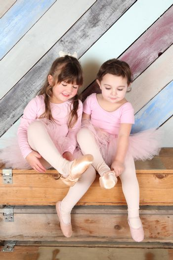 Friends playing dress-up in ballet costumes against colorful background