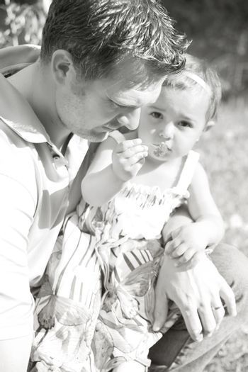 Father and daughter outside in the field