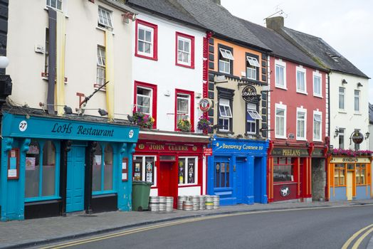 pubs and retaurant fronts on a kilkenny city high street in ireland