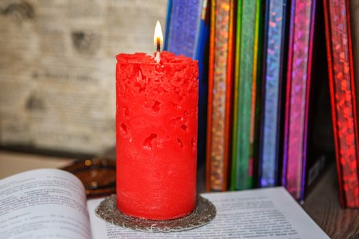 Composition of the burning red openwork handmade candles among c