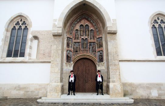Guard of Honor of the Cravat Regiment on the south portal of the church of St. Mark in Zagreb, Croatia on September 20, 2014