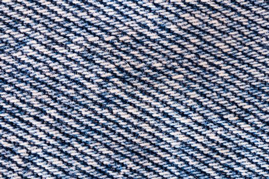 Texture of blue jeans. Shot from close range.