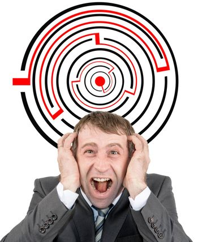 Shouting businessman against entrance to difficult maze puzzle