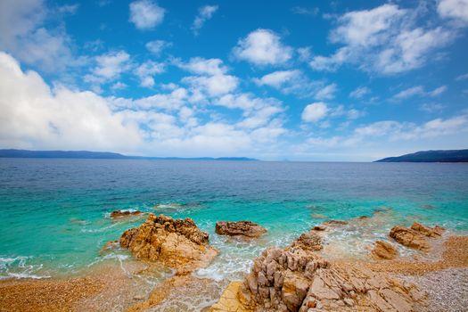 Small Adriatic coastline Croatia. Clear azure water under blue s