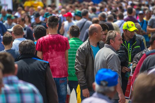 NOVI SAD, SERBIA - MAY 19, 2016: Crowd of people walking at 83rd traditional annual international Agricultural fair in Novi Sad, largest agribusiness event in Serbia and one of the largest in Europe.