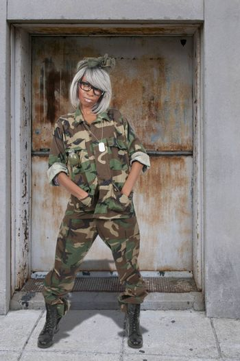 Beautiful young woman soldier in camouflage