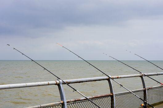 Sea fishing rods on pier