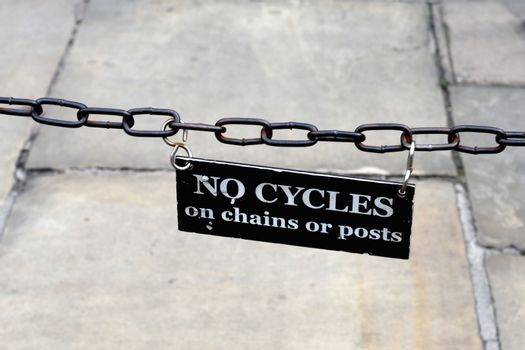 No Cycling sign on chain
