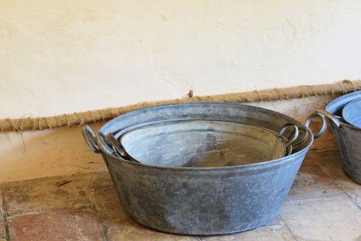 cast iron washing tubs on floor