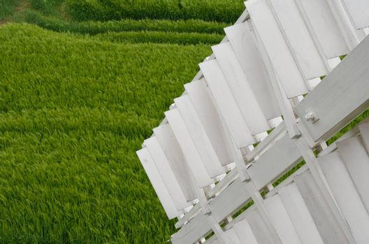 Detail of sail of window with field in background