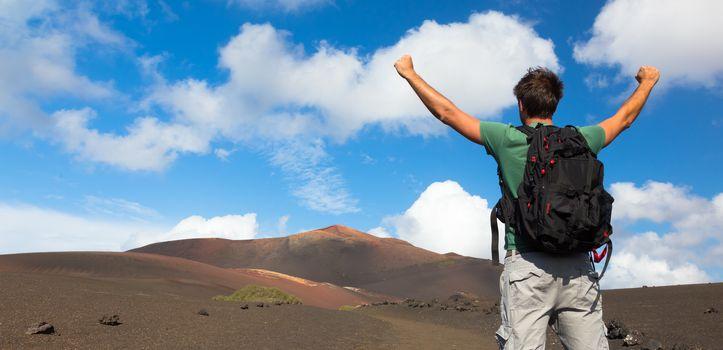 Man reaching the top of mountain.