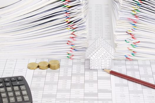 Pencil and house with coins have dual document as background