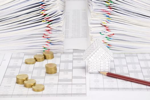 House and pencil with coins have dual document as background