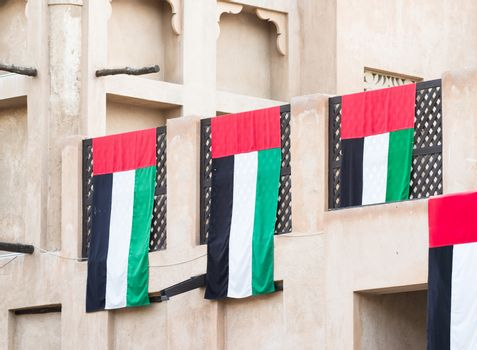 UAE flags on traditional house