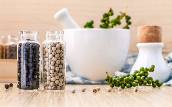 Assorted of spice bottles condiment black pepper ,white pepper a