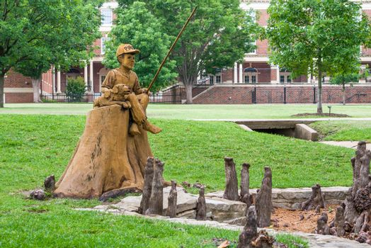STILLWATER, OK/USA - MAY 20, 2016: Boy and Dog Fishing Sculpture at Theta Pond on the campus of Oklahoma State University.
