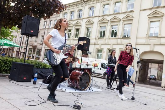 VILNIUS, LITHUANIA - MAY 21, 2016: Teenage girl rock band performing on the street at traditional street music day in Vilnius, Lithuania