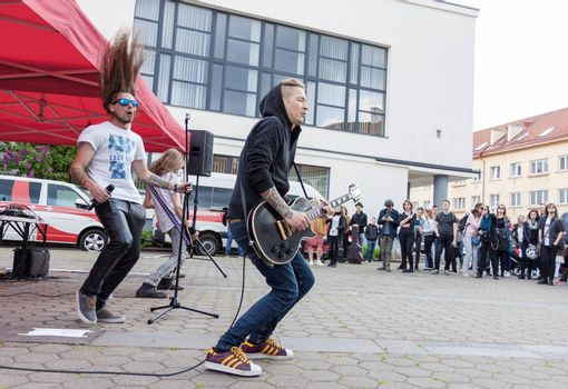 VILNIUS, LITHUANIA - MAY 21, 2016: Rock band performing on the street at traditional street music day in Vilnius, Lithuania
