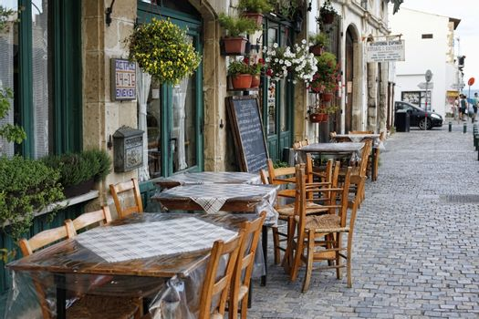 Larnaca, Cyprus - May 23, 2016: The outdoor cafe decorated with flowers in pots. Larnaca, Cyprus.