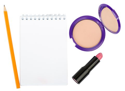 Open copybook with lipstick and powder