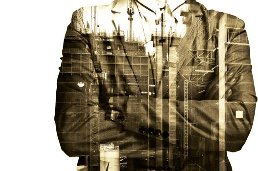 Double exposure Businessman or Civil Engineer stand with Construction site do examination, inspection, survey as Real Estate Development concept