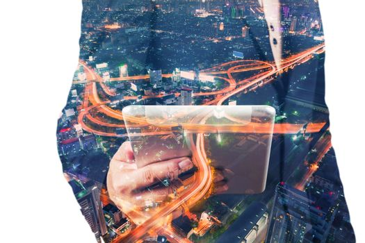 Double Exposure of BusinessMan hold Digital Tablet with Modern City Building and Highway as Digital Technology concept