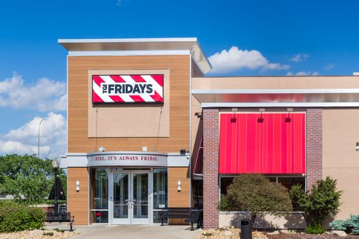 BLOOMINGTON, MN/USA - MAY 29, 2016: TGI Fridays exterior and logo. TGI Friday's is an American restaurant chain focusing on casual dining.