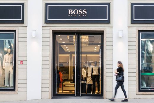 VILNIUS, LITHUANIA - MAY 03, 2016: View of Hugo Boss luxury fashion house store entrance with brand signage in Vilnius, Lithuania