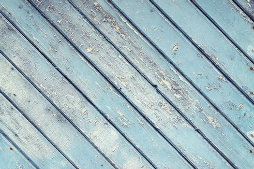 Old wooden planks texture with weathered blue paint