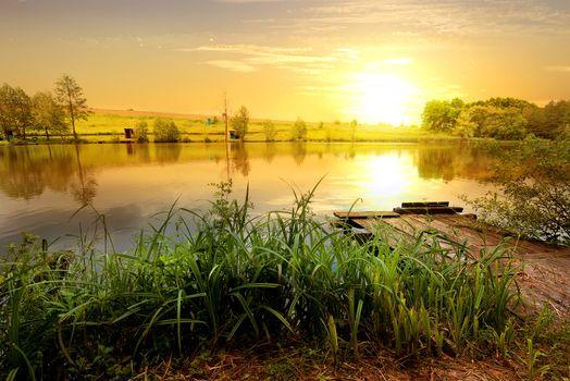 Yellow sunset on pond