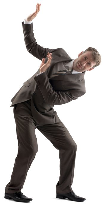 Embarrassed businessman defending with body
