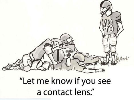 football player looks for lens