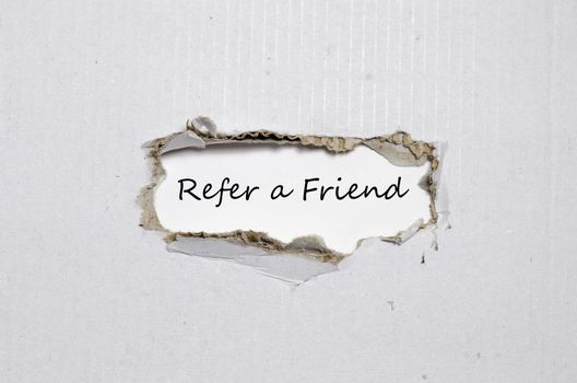 The word refer a friend appearing behind torn paper.