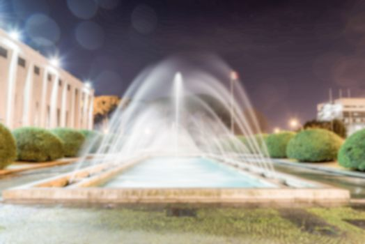 Defocused background of neoclassical fountain in Rome, Italy