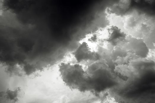 Dark stormy clouds obscuring sun