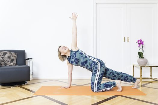 An image of a woman doing yoga at home
