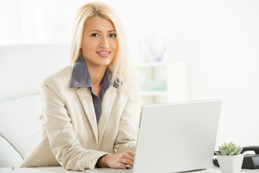 Blonde Businesswoman At Workplace