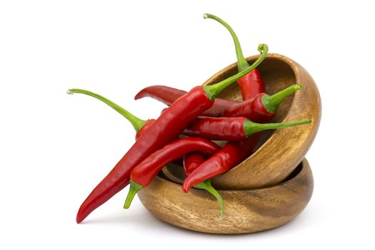 chili peppers in a bowl on white background