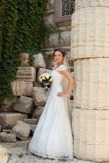 girl, wedding, expensive dress, summer day, the bride with large eyes