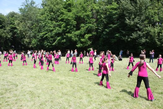 BELGRADE,SERBIA - JUN 11,2016:Little girls dance at the opening of kites flying competition