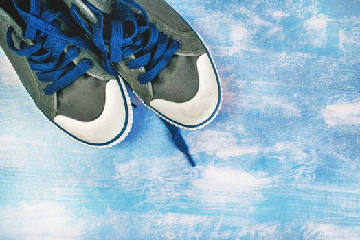 New sneakers on grunge surface
