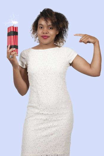 Young woman holding several sticks of dynamite