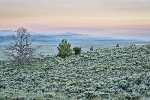 dawn over mountains covered by wildfire smoke - North Park, Colorado near Wyoming border (june 20, 2016)