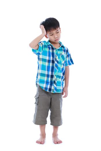 Full body. Attractive 7 year old boy making thinking expression.