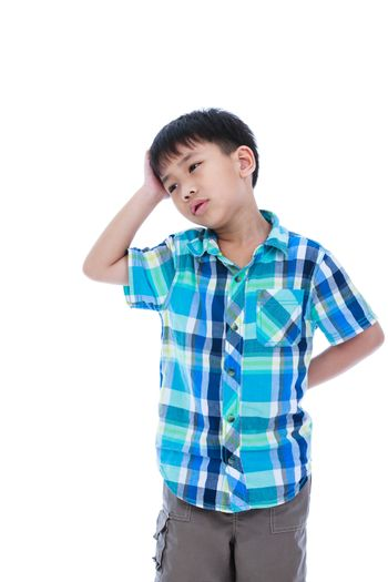 Attractive 7 year old boy making thinking expression. Isolated o